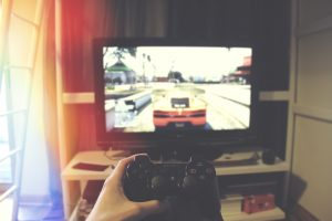 video game console in front of screen